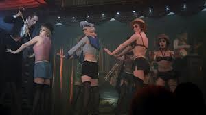Joel Grey as the M.C. with the Kit Kat Girls