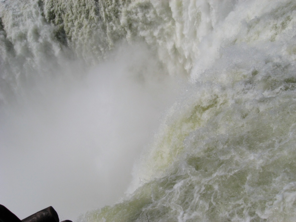 Staring down the Devil's Mouth, the most massive waterfall of Foz do Iguacu, shaped like a horseshoe